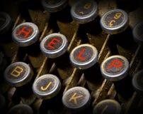 Chiavi della macchina da scrivere di aiuto Immagini Stock
