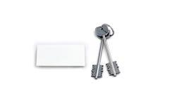 Tasti domestici e quadrato bianco fotografia stock