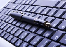 Tastiera & penna Fotografia Stock