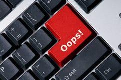 Tastiera con Oops chiave rosso! immagini stock