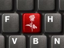 Tastiera del PC con il tasto del fiore immagini stock libere da diritti