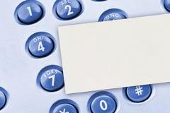 Tastiera del telefono e scheda di carta Fotografie Stock