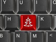 Tastiera di computer con la chiave dell'albero di Natale Immagini Stock