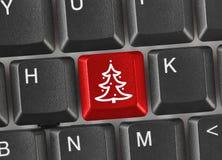 Tastiera di computer con la chiave dell'albero di Natale Immagini Stock Libere da Diritti
