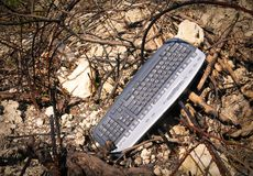 Tastiera di computer nei rifiuti Immagine Stock