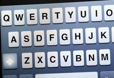 Tastiera di qwerty sulla compressa Immagini Stock