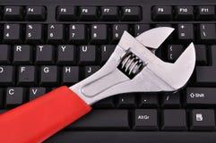 Tastiera e chiave Immagini Stock