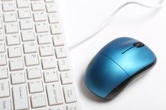 Tastiera e mouse blu Immagine Stock
