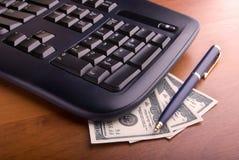 Tastiera e soldi Immagini Stock Libere da Diritti