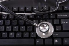 Tastiera e stetoscopio Fotografia Stock Libera da Diritti