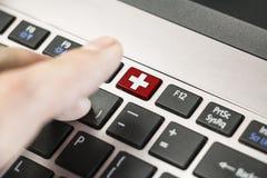 Tastiera ed ambulanza Immagine Stock