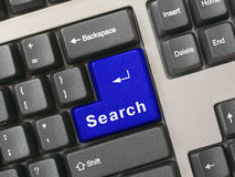 Tastiera - ricerca chiave blu Fotografia Stock