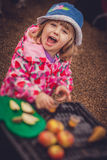 Tasting apple juice. Portrait of a cute little girl tasting fresh organic apple juice at a local farmers market Royalty Free Stock Images