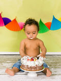 Tasting birthday cake Royalty Free Stock Photography