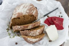 Tasting bread cheese dish with herbs and meat. On white table Stock Photos