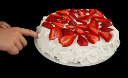 Tasting cake Stock Images