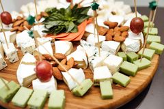 Tasting cheese dish . Delicious cheese on the table. Table setting at a luxury wedding reception. royalty free stock photography