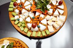 Tasting cheese dish . Delicious cheese on the table. Table setting at a luxury wedding reception. stock photos
