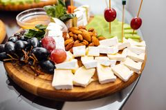 Tasting cheese dish . Delicious cheese on the table. Table setting at a luxury wedding reception. royalty free stock images