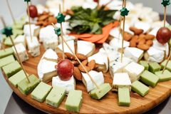 Tasting cheese dish . Delicious cheese on the table. Table setting at a luxury wedding reception. stock photography