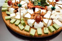 Tasting cheese dish . Delicious cheese on the table. Table setting at a luxury wedding reception. royalty free stock photo