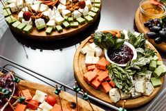 Tasting cheese dish . Delicious cheese on the table. Table setting at a luxury wedding reception. stock photo