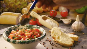 tasting chopped tomatoes stock video footage