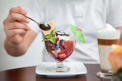 Tasting a cup of ice cream with fruits and coffee Royalty Free Stock Image