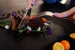 Tasting exotic restaurant gourmet food Royalty Free Stock Images