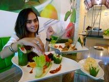 Tasting food Stock Image