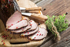 Tasting fresh piece of ham in a smokehouse Royalty Free Stock Image