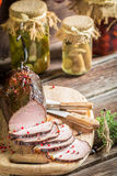 Tasting fresh piece of ham in a smokehouse Royalty Free Stock Photo