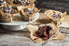 Tasting freshly baked chocolate muffins Royalty Free Stock Photography