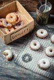 Tasting freshly baked donuts Royalty Free Stock Image