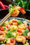 Tasting fried shrimp with fresh herbs Stock Image