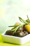 Tasting olive Stock Photography