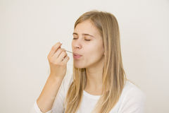 Tasting remedy in spoon. Tasting remedy or yogurth in spoon stock image