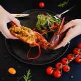 Tasting restaurant stuffed lobster dish Royalty Free Stock Images