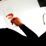 Tasting-Rosé wine pour in a glass Stock Photo