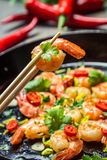 Tasting shrimp with herbs Stock Photography