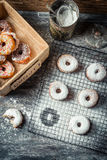 Tasting sweet donuts with icing sugar Stock Photo
