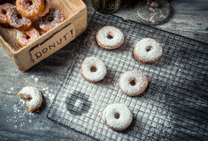 Tasting sweet donuts with icing sugar Stock Image