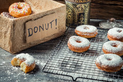 Tasting sweet donuts with icing sugar Stock Photography
