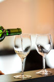 Tasting-White wine pour in a glass Stock Photos