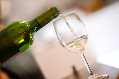 Tasting-White wine pour in a glass. Bordeaux Vineyard Stock Image