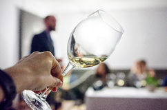 Tasting white wine Stock Photo