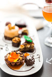 Tasting of wine and pattie chocolate pastries at the chocolate. Stock Photography