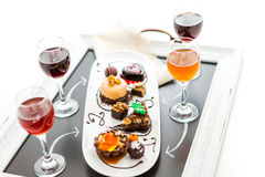 Tasting of wine and pattie chocolate pastries at the chocolate. Stock Photos