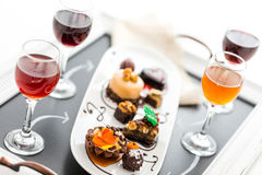 Tasting of wine and pattie chocolate pastries at the chocolate. Royalty Free Stock Photography