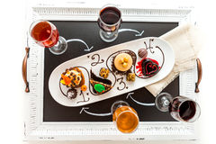 Tasting of wine and pattie chocolate pastries at the chocolate. Royalty Free Stock Image